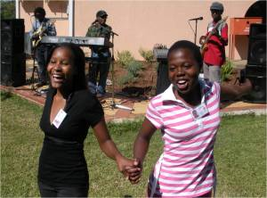 Two Gaborone Teen Club members dancing to Afro-Caribbean music played by renowned music artist Momo (middle, background) and his band. (Photo courtesy of Ed Pettitt)
