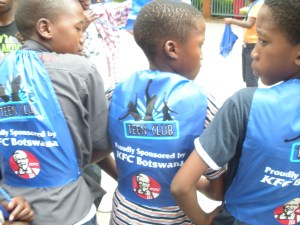Teen Club members show off their new sports bags courtesy of KFC Botswana! (Photo courtesy of Ed Pettitt)