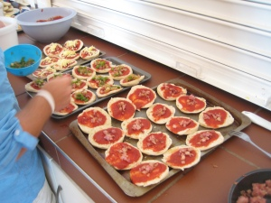 Mochudi Teen Club members enjoy mini pizzas during their Teen Leader elections! (Photo courtesy of Pavlo Bereas)