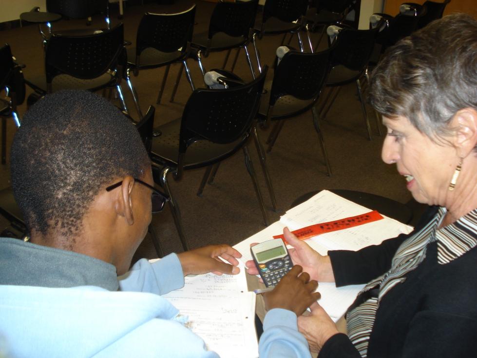 Student is tutored by one of the Teen Club Volunteers